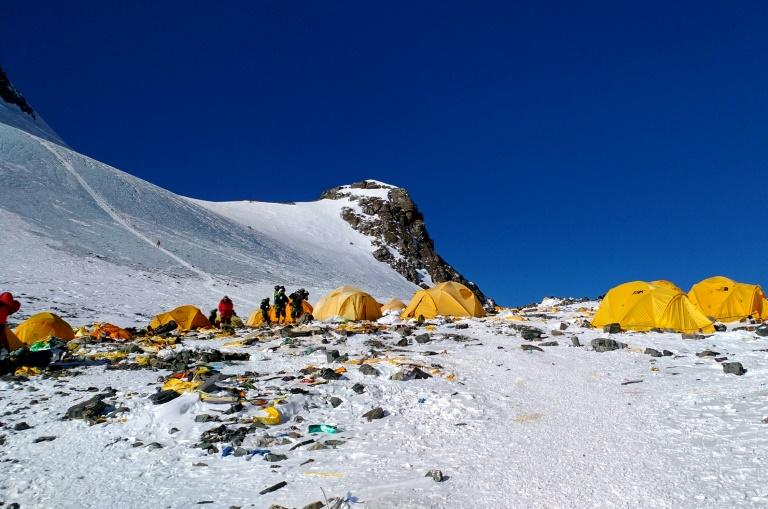 Discarded climbing equipment and rubbish scattered around Camp 4 of Mount Everest, where decades of commercial mountaineering have left a trail of discarded waste