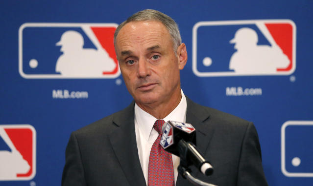 Baseball Commissioner Rob Manfred listens to a question following the two-day meeting of Major League Baseball owners, Thursday, Aug. 17, 2017, in Chicago. (AP)
