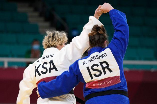 Tahani Alqahtani of Saudi Arabia, left, and Raz Hershko of Israel react after competing in their women's +78kg elimination round judo match at the 2020 Summer Olympics, Friday, July 30, 2021, in Tokyo, Japan. (AP Photo/Vincent Thian) (Photo: via Associated Press)