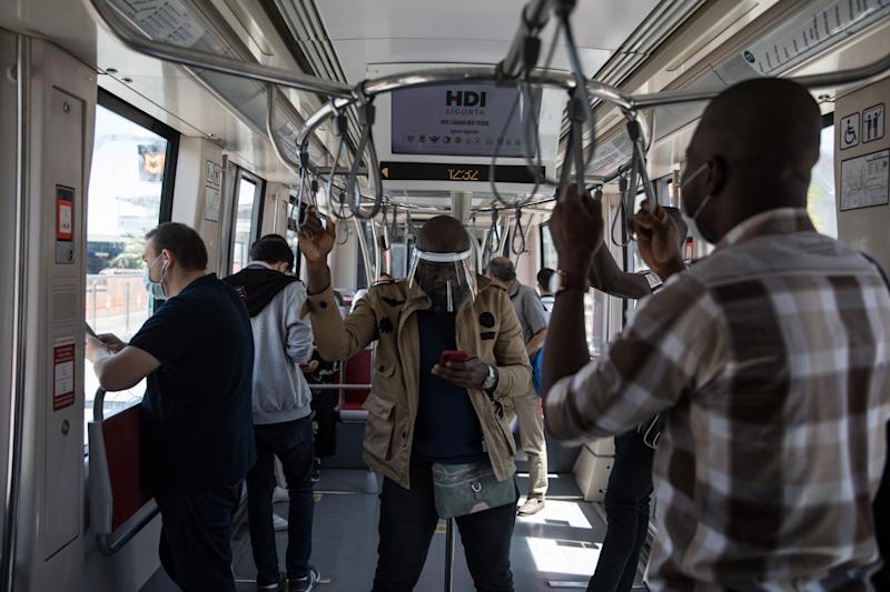 "People seen in tram while people wear a mask in Istanbul, Turkey on June 05, 2020. The Turkish government took a set of decisions to ease restrictions against the novel coronavirus (COVID-19) for the ""new normal"" process. (Photo by Cem Tekkeinolu/NurPhoto via Getty Images)"