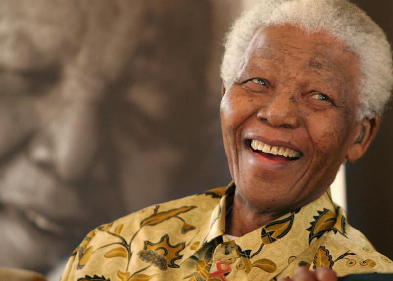 FILE - In this Dec. 7, 2005 file photo, former South African President Nelson Mandela, 87, is in a jovial mood at the Mandela Foundation in Johannesburg. The emotional pain and practical demands facing Nelson Mandela's family are universal: confronting the final days of an elderly loved one. There are no rules for how or when the end may arrive. Mandela's status as a respected global figure only complicates the situation, doctors and end-of-life experts say.(AP Photo/Denis Farrell, File)