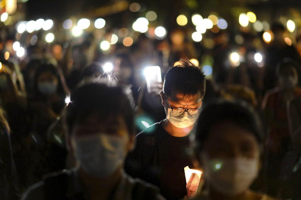 People take part in a candlelight vigil at Kwun Tong Waterfront on June 4 last year. Photo: K.Y. Cheng