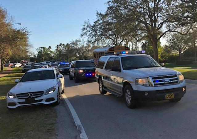 <p>Police and security vehicles are seen at Marjory Stoneman Douglas High School in Parkland, Florida, a city about 50 miles (80 kilometers) north of Miami on Feb. 14, 2018 following a school shooting.<br> (Photo: Michele Eve Sandberg/AFP/Getty Images) </p>