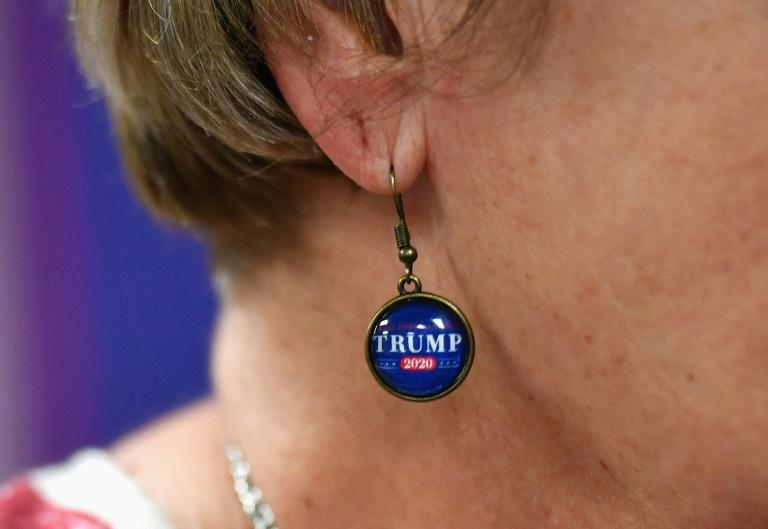 A Trump supporter models her earrings dedicated to the US president
