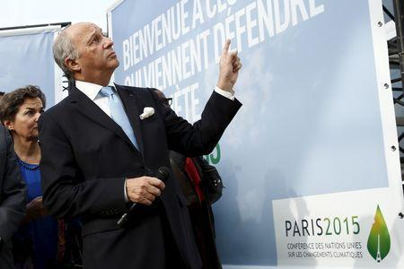 Executive Secretary of the United Nations Framework Convention on Climate Change (UNFCCC) Christiana Figueres (L) and French Minister of Foreign Affairs Laurent Fabius (R) visit the work site where the forthcoming COP 21 World Climate Summit will be held at Le Bourget, near Paris, France, November 8, 2015. REUTERS/Benoit Tessier