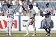 Tampa Bay Rays right fielder Manuel Margot high-fives second baseman Brandon Lowe (8) after defeating the New York Yankees in a baseball game on Saturday, Oct. 2, 2021, in New York. The Rays won 12-2. (AP Photo/Adam Hunger)