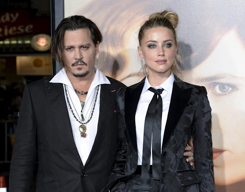"Cast member Amber Heard and husband Johnny Depp pose during the premiere of the film ""The Danish Girl,"" in Los Angeles, California November 21, 2015. REUTERS/Kevork Djansezian/File Photo"