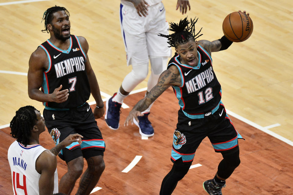 Memphis Grizzlies guard Ja Morant (12) handles the ball after a dunk in the first half of an NBA basketball game against the Los Angeles Clippers Thursday, Feb. 25, 2021, in Memphis, Tenn. (AP Photo/Brandon Dill)