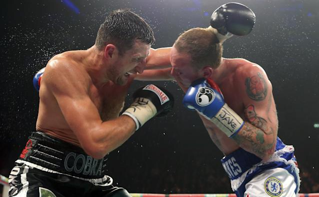 Carl Froch of Britain, left, exchanges punches with compatriot George Groves during their WBA and IBF super-middleweight title fight at the Phones 4u Arena, in Manchester, England, Saturday, Nov. 23, 2013. Froch recovered from a first-round knockdown to retain his WBA and IBF super-middleweight titles with a ninth-round technical knockout of Groves in an engrossing fight on Saturday. (AP Photo/Dave Thompson, PA Wire)