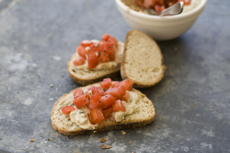 This Sept. 30, 2013 photo shows Italian-style hummus with diced tomatoes in Concord, N.H. (AP Photo/Matthew Mead)