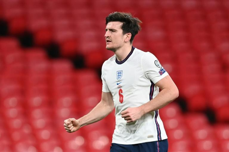 England defender Harry Maguire celebrates scoring the winner in their World Cup qualifier against Poland
