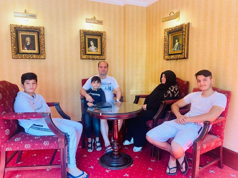 Sayed Hashemi, his wife Lida and their three sons at their hotel in Canterbury (Sayed Hashemi)