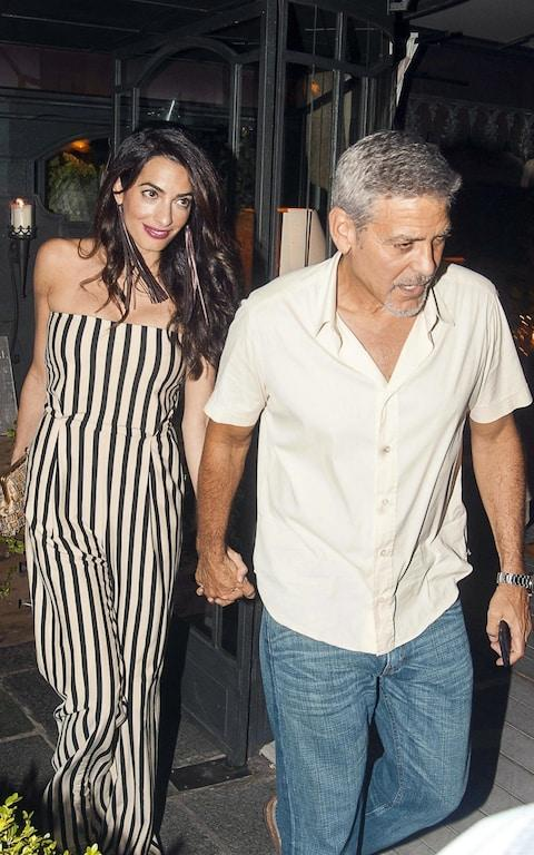 Amal Clooney wears Elisabetta Franchi with George Clooney