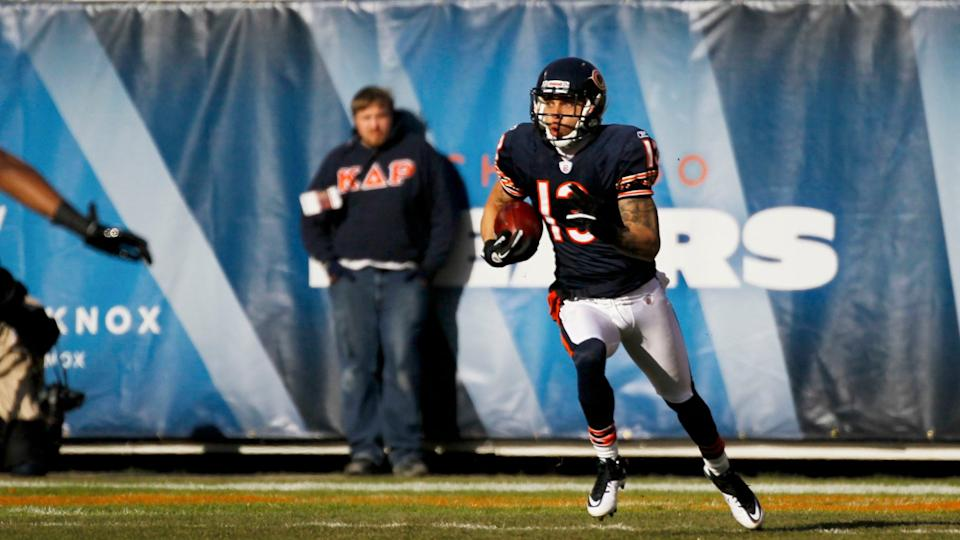 Mandatory Credit: Photo by Charles Rex Arbogast/AP/Shutterstock (6025639g)Johnny Knox Chicago Bears' Johnny Knox (13) returns the opening kickoff closes in during first half of an NFL football game against the Seattle Seahawksin ChicagoSeahawks Bears Football, Chicago, USA.