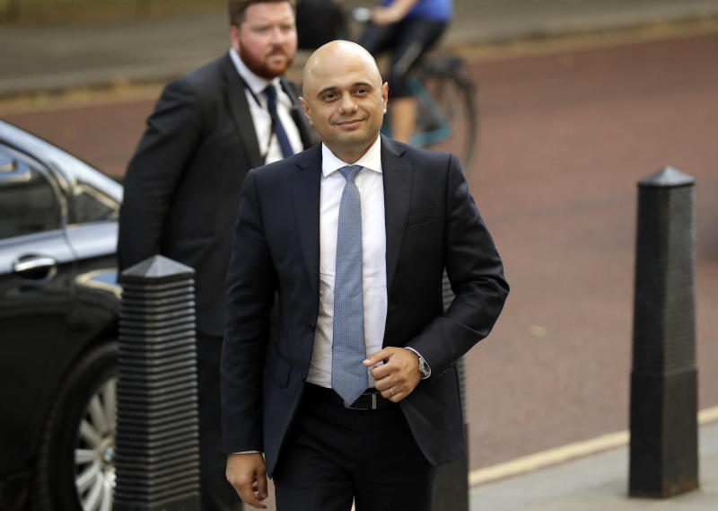 Britain's new Chancellor Sajid Javid arrives at the treasury in London, Wednesday, July 24, 2019. British Prime Minister Boris Johnson has appointed Sajid Javid the country's new Treasury chief, one of the most senior jobs in Cabinet. Javid will be responsible for spending and economic policy in Johnson's government. (AP Photo/Matt Dunham)