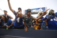 Winnipeg Blue Bombers fans celebrate after wide receiver Kenny Lawler scored a touchdown against the Hamilton Tiger-Cats during the first half of a Canadian Football League game Thursday, Aug. 5, 2021, in Winnipeg, Manitoba. (John Woods/The Canadian Press via AP)