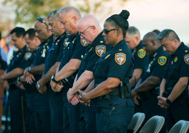 PHOTO: Harris County Sheriff's Office deputies bow their heads in prayer during a vigil for Harris County Sheriff's Office Deputy Sandeep Dhaliwal in Houston, Texas, Sept. 30, 2019. (Mark Mulligan/Houston Chronicle via AP)