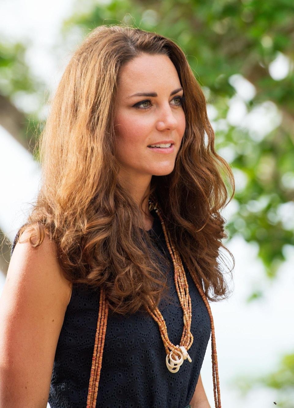 <p>Humidity doesn't stop the duchess's hair from looking great. She showed off her natural hair texture during a visit to Tuvanipupu Island, allowing us to see her fluffy waves and curls in all their glory. </p>
