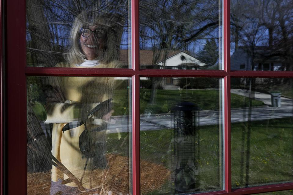 """Jody Garrison is seen inside her home Wednesday May 13, 2020, in Milwaukee. Two months into the crisis, millions of Americans are struggling to cope with the fallout, whether it's losing loved ones, losing a job or staying at home more than they ever have. Among those grappling with the new dynamics is Garrison, who works from her Milwaukee home, turning old books into journals and selling them online. It's the rare trip to the grocery store — or to the auto mechanic shop later this week to pick up her car after a repair — that brings on the anxiety. """"You worry about, 'Am I going to catch something from touching something?' so I truly don't go out in public much at all,"""" she said by telephone. (AP Photo/Morry Gash)"""
