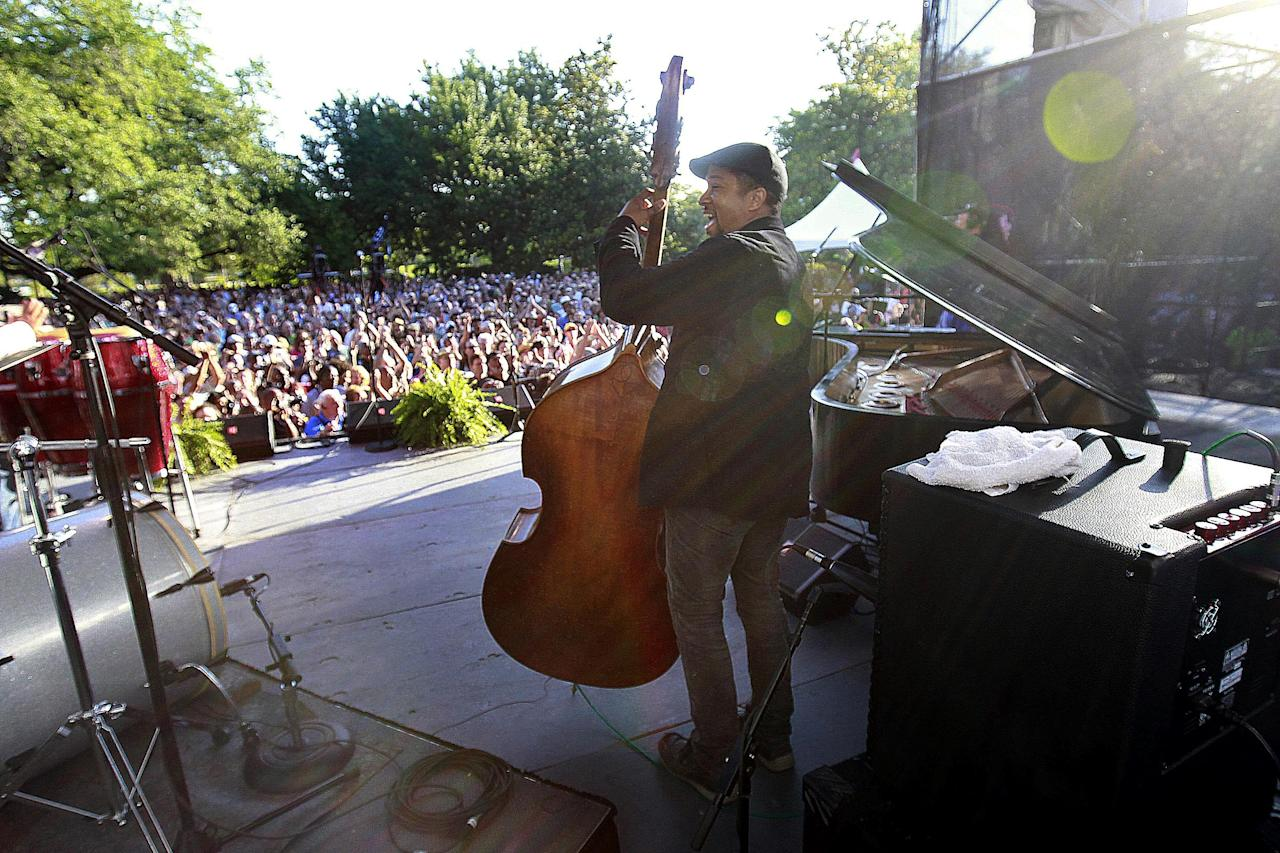 Bassist Roland Guerin performs at a sunrise concert marking International Jazz Day in New Orleans, Monday, April 30, 2012. The performance, at Congo Square near the French Quarter, is one of two in the United States that day; the other is in the evening in New York. Thousands of people across the globe are expected to participate in International Jazz Day, including events in Belgium, France, Brazil, Algeria and Russia. (AP Photo/Gerald Herbert)
