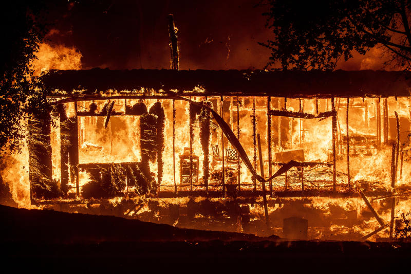 Flames consume a home as the Kincade Fire tears through the Jimtown community of Sonoma County, Calif., on Thursday, Oct. 24, 2019. (Photo: Noah Berger/AP)