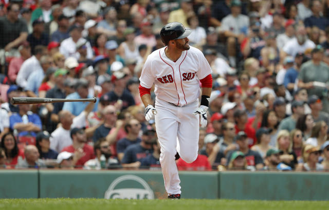Boston Red Sox's J.D. Martinez watches his home run against the Toronto Blue Jays during the fourth inning of a baseball game Saturday, July 14, 2018, in Boston. (AP Photo/Winslow Townson)