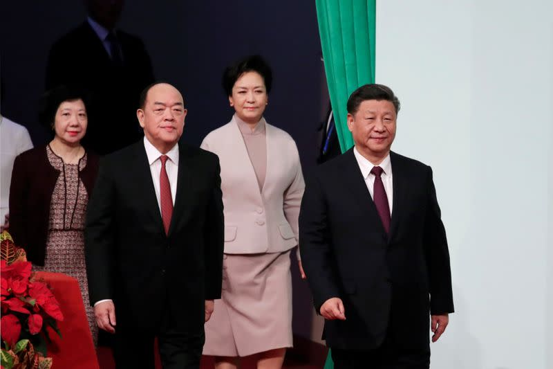 Chinese President Xi Jinping, new Macau Chief Executive Ho Iat-seng, Xi's wife Peng Liyuan and Ho's wife Zheng Suzhen arrive for a ceremony on the 20th anniversary of the former Portuguese colony's return to China in Macau