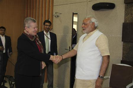 U.S. ambassador to India Nancy Powell (2nd L) shakes hands with Hindu nationalist Narendra Modi (R), prime ministerial candidate for India's main opposition Bharatiya Janata Party (BJP) and Gujarat's chief minister, during their meeting in Gandhinagar in the western Indian state of Gujarat February 13, 2014. REUTERS/Gujarat Information Department/Handout via Reuters