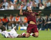Portugal's Cristiano Ronaldo is sent flying by France's Patrick Vieira (Photo by Mike Egerton - PA Images via Getty Images)