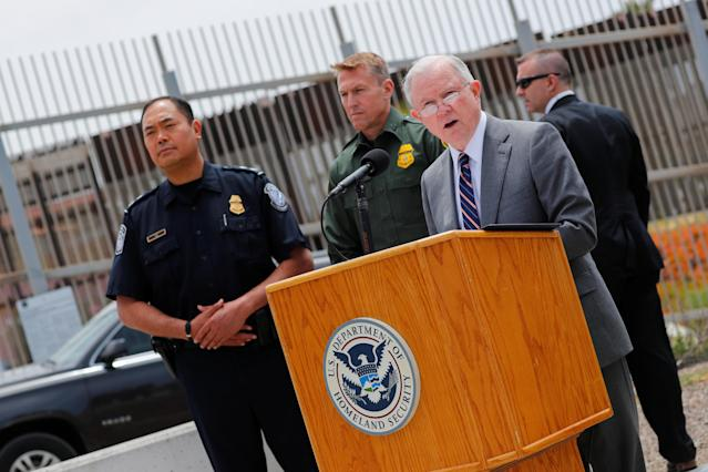 Attorney General Jeff Sessions holds a news conference next to the U.S.-Mexico border wall. (Photo: Mike Blake/Reuters)