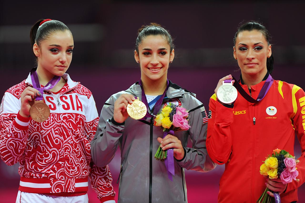 (R-L) Silver medalist Catalina Ponor of Romania, gold medalist Alexandra Raisman of the United States of America and bronze medalist Aliya Mustafina of Russia pose on the podium during the medal ceremony for the on Day 11 of the London 2012 Olympic Games at North Greenwich Arena on August 7, 2012 in London, England.  (Photo by Michael Regan/Getty Images)