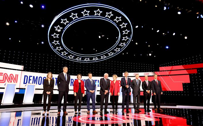 Democratic Presidential candidates line up waving to the crowd before the start of the debate at the Fox Theatre in Detroit, Michigan on Tuesday, July 30, 2019. (L to R) Marianne Williamson, Tim Ryan, Sen. Amy Klobuchar, Mayor of South Bend, Indiana, Pete Buttigieg, Sen. Bernie Sanders, Sen. Elizabeth Warren, Beto O'Rourke, John Hickenlooper, John Delaney and Montana Governor, Steve Bullock.