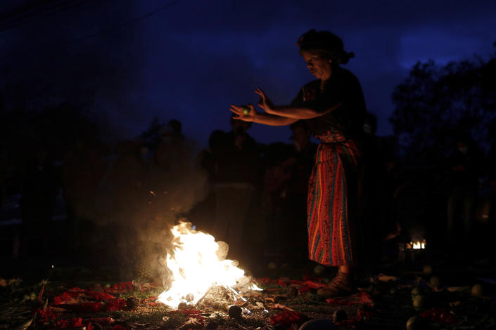 An Indigenous leader prays during a spiritual ceremony before the start of a trial against one of the alleged masterminds of the killing the environmental and Indigenous rights activist Berta Caceres, in Tegucigalpa, Honduras, Monday, April 5, 2021. The trial of Roberto David Castillo is expected to run through April. The government has already convicted seven people in Caceres' murder, but is Castillo is considered a potentially critical link to those who ordered it. (AP Photo/Elmer Martinez)