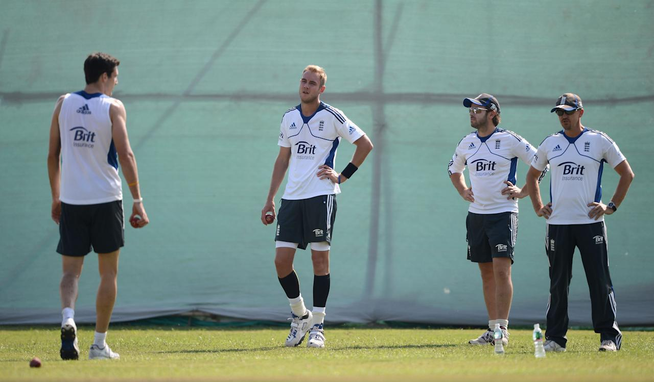 AHMEDABAD, INDIA - NOVEMBER 11:  Steven Finn and Stuart Broad of England bowl in the nets watched by coach Andy Flower and team Physiotherapist Ben Langley during day four of the tour match between England and Haryana at Sardar Patel Stadium ground B on November 11, 2012 in Ahmedabad, India.  (Photo by Gareth Copley/Getty Images)