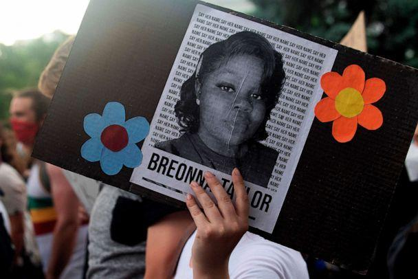 PHOTO: A demonstrator holds a sign with the image of Breonna Taylor, a black woman who was fatally shot by Louisville Metro Police Department officers, during a protest against the death George Floyd in Minneapolis, in Denver, June 3, 2020. (Brett Carlsen/AFP via Getty Images)