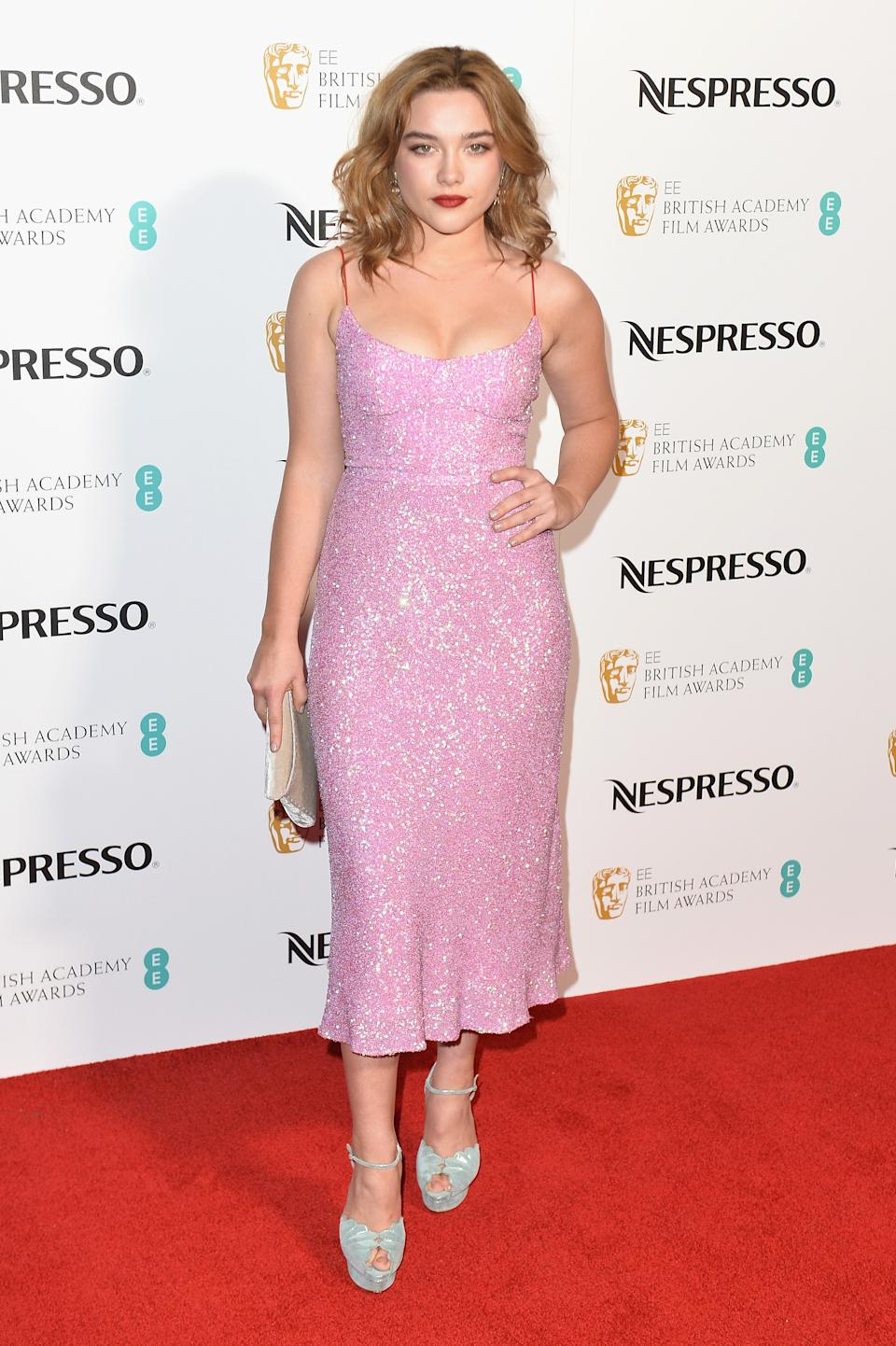 Wearing a pink, sparkly dress. <em>[Photo: Getty]</em>