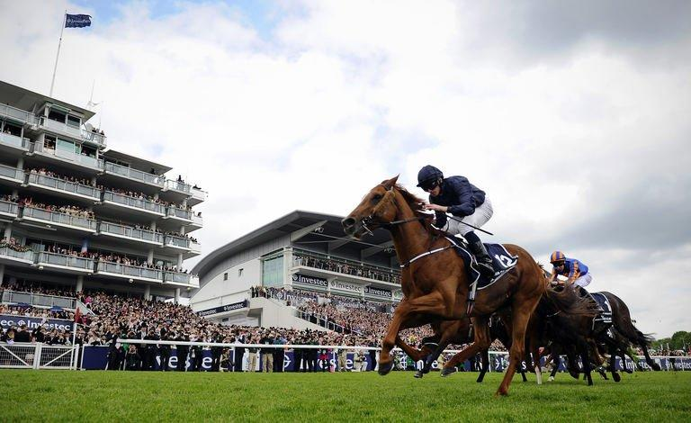 Ryan Moore wins the Derby on Ruler of the World in Surrey, southern England, on June 1, 2013