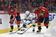 Tampa Bay Lightning defenseman Victor Hedman (77) and Washington Capitals center Nicklas Backstrom (19) and left wing Alex Ovechkin (8), of Russia, battle for the puck during the first period of an NHL hockey game, Saturday, Dec. 21, 2019, in Washington. (AP Photo/Nick Wass)