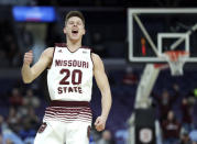 Missouri State's Ryan Kreklow celebrates after making a 3-point basket during the first half of an NCAA college basketball game against Bradley in the quarterfinal round of the Missouri Valley Conference tournament, Friday, March 8, 2019, in St. Louis. (AP Photo/Jeff Roberson)