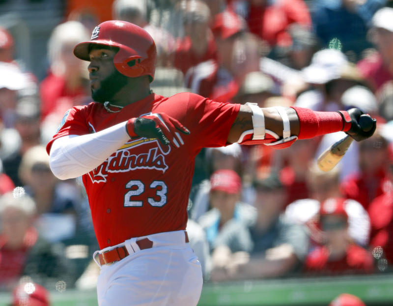 The St. Louis Cardinals hope the addition of Marcell Ozuna helps them catch the Cubs. (AP Photo/John Bazemore)