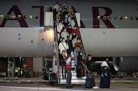 Evacuees from Afghanistan arrived from Kabul at Hamad International Airport in Qatar's capital Doha on the evening of September 10, 2021 (AFP/KARIM JAAFAR)