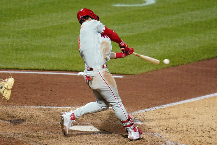 Philadelphia Phillies' Bryce Harper hits an RBI single off Pittsburgh Pirates relief pitcher David Bednar during the eighth inning of a baseball game in Pittsburgh, Saturday, July 31, 2021. (AP Photo/Gene J. Puskar)