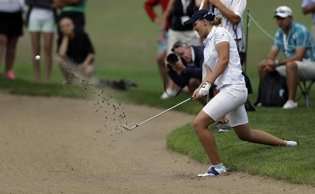 Great Britain and Ireland's Gabriella Cowley hits out of a bunker on the fourth hole during second day of the 38th Curtis Cup amateur golf match against the United States Saturday, June 7, 2014, in St. Louis. (AP Photo/Jeff Roberson)