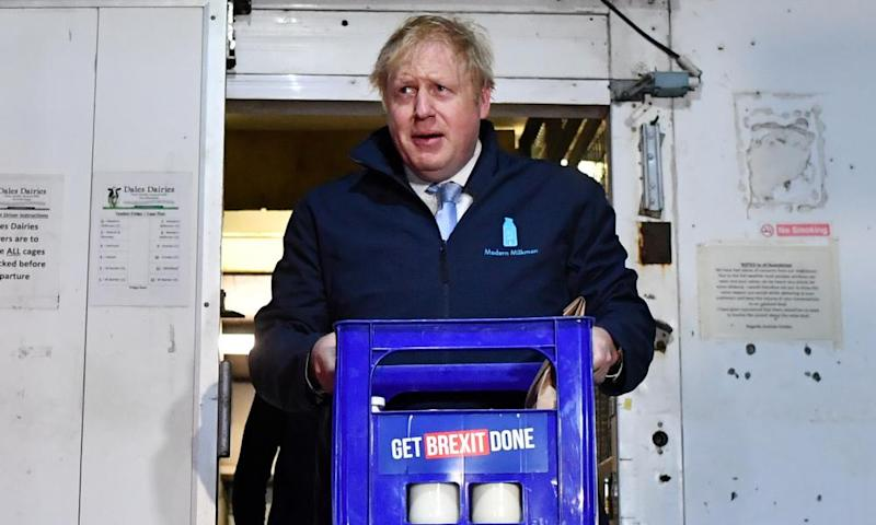 Boris Johnson carrying a crate of milk in Guiseley, Leeds the morning before the general election.
