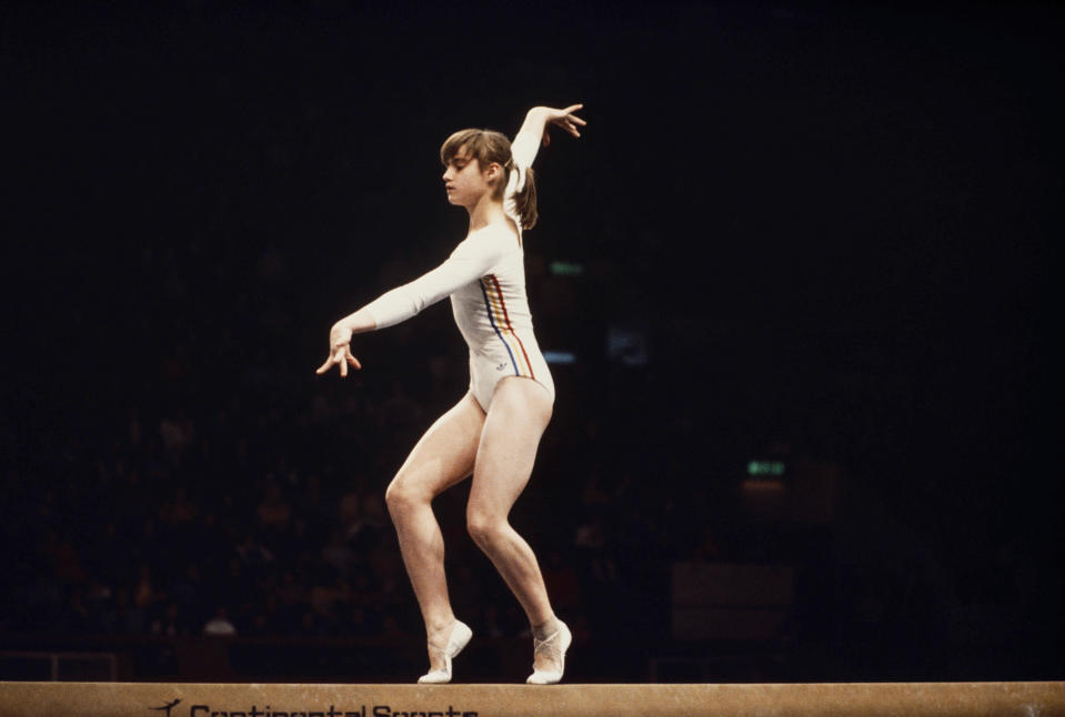 <p>At the 1976 Summer Games in Montreal, Romanian Nadia Comaneci won three gold medals and became the first female gymnast to receive a perfect 10 at an Olympics gymnastics event. (Getty) </p>