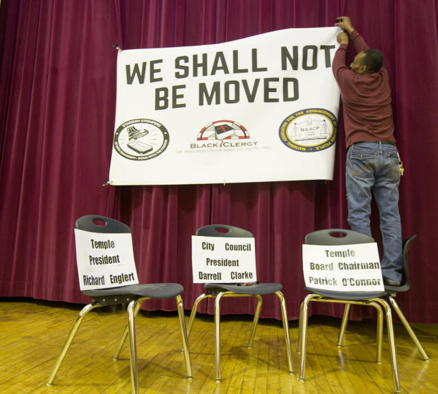 "Neighbors opposing the stadium carried ""We Shall Not Be Moved"" signs as Temple (briefly) made its case for the $130 million plan. (Via Philly.com)"