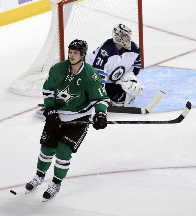 Dallas Stars team captain Jamie Benn skates away after his shootout attempt against Winnipeg Jets' Ondrej Pavelec (31), of Czech Republic, hit off the post in overtime of an NHL hockey game, Saturday, Oct. 26, 2013, in Dallas. The Jets' Andrew Ladd scored the only shootout goal in the 2-1 Jets win. (AP Photo/Tony Gutierrez)