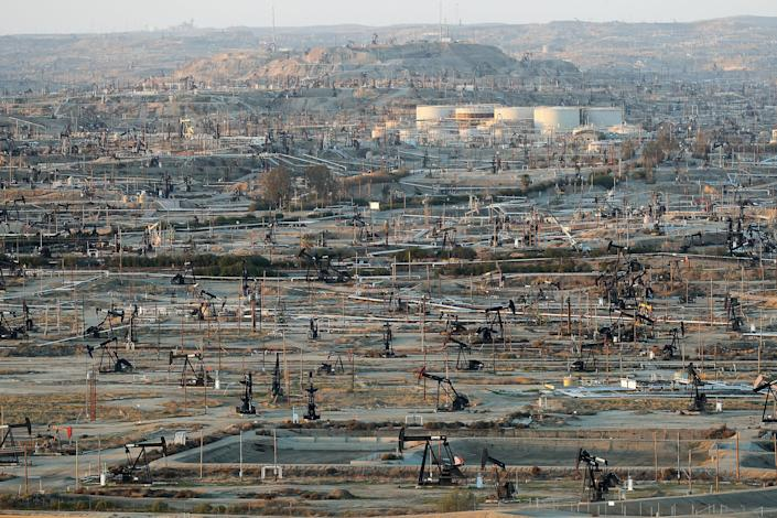 Oilfield infrastructure dominates the landscape at the densely developed Kern River oil field just outside of Bakersfield, California, Feb. 20, 2020.