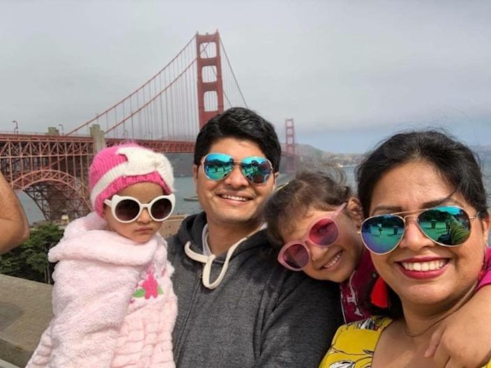 """Poorva Dixit and her family pose for a photo in Northern California, where both she and her husband worked prior to being separated by the president's executive order on visas. <span class=""""copyright"""">(Poorva Dixit)</span>"""