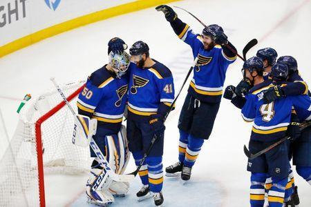 May 21, 2019; St. Louis, MO, USA; St. Louis Blues goaltender Jordan Binnington (left) and defenseman Robert Bortuzzo (41) celebrate their win over the San Jose Sharks in game six of the Western Conference Final of the 2019 Stanley Cup Playoffs at Enterprise Center. The St. Louis Blues won 5-1. Mandatory Credit: Billy Hurst-USA TODAY Sports